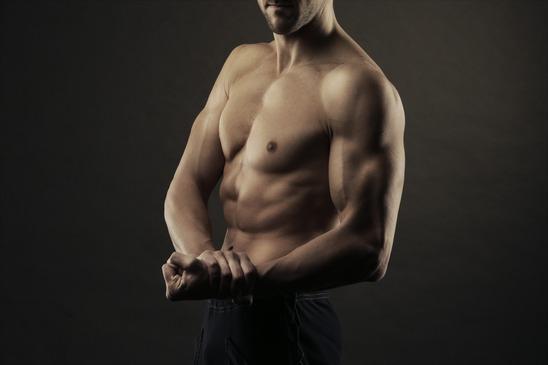 photodune-4150585-body-builder-flexing-biceps-xs.jpg